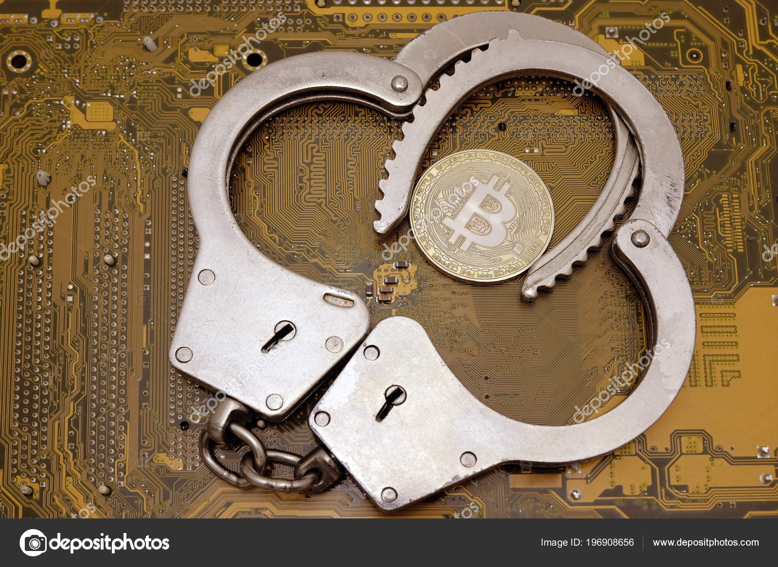 The concept of violation of the law in the crypto-currency sphereor hacker attack. Bitcoin in the open police handcuffs as in a vice against the background of a yellow computer circuit board.